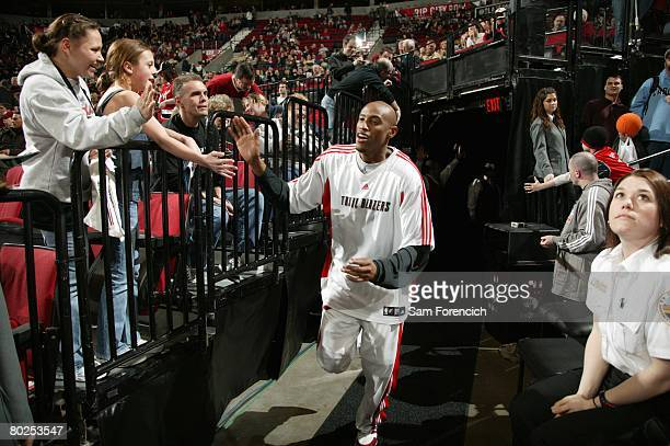 Travis Outlaw of the Portland Trail Blazers greets fans as he runs out of the tunnel prior to the game against the Boston Celtics at The Rose Garden...