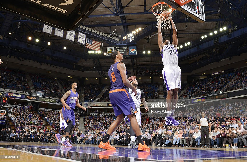 <a gi-track='captionPersonalityLinkClicked' href=/galleries/search?phrase=Travis+Outlaw&family=editorial&specificpeople=203322 ng-click='$event.stopPropagation()'>Travis Outlaw</a> #25 of the Sacramento Kings dunks against the Phoenix Suns on November 19, 2013 at Sleep Train Arena in Sacramento, California.