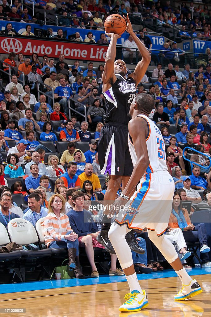 <a gi-track='captionPersonalityLinkClicked' href=/galleries/search?phrase=Travis+Outlaw&family=editorial&specificpeople=203322 ng-click='$event.stopPropagation()'>Travis Outlaw</a> #25 of the Sacramento Kings shoots a three-pointer against <a gi-track='captionPersonalityLinkClicked' href=/galleries/search?phrase=Kevin+Durant&family=editorial&specificpeople=3847329 ng-click='$event.stopPropagation()'>Kevin Durant</a> #35 of the Oklahoma City Thunder on April 15, 2013 at the Chesapeake Energy Arena in Oklahoma City, Oklahoma.