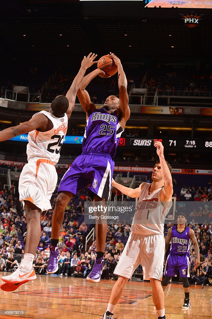 <a gi-track='captionPersonalityLinkClicked' href=/galleries/search?phrase=Travis+Outlaw&family=editorial&specificpeople=203322 ng-click='$event.stopPropagation()'>Travis Outlaw</a> #25 of the Sacramento Kings shoots against <a gi-track='captionPersonalityLinkClicked' href=/galleries/search?phrase=Dionte+Christmas&family=editorial&specificpeople=4091611 ng-click='$event.stopPropagation()'>Dionte Christmas</a> #25 of the Phoenix Suns on November 20, 2013 at U.S. Airways Center in Phoenix, Arizona.