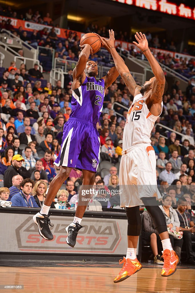 <a gi-track='captionPersonalityLinkClicked' href=/galleries/search?phrase=Travis+Outlaw&family=editorial&specificpeople=203322 ng-click='$event.stopPropagation()'>Travis Outlaw</a> #25 of the Sacramento Kings shoots against Marcus Morris #15 of the Phoenix Suns on December 13, 2013 at U.S. Airways Center in Phoenix, Arizona.