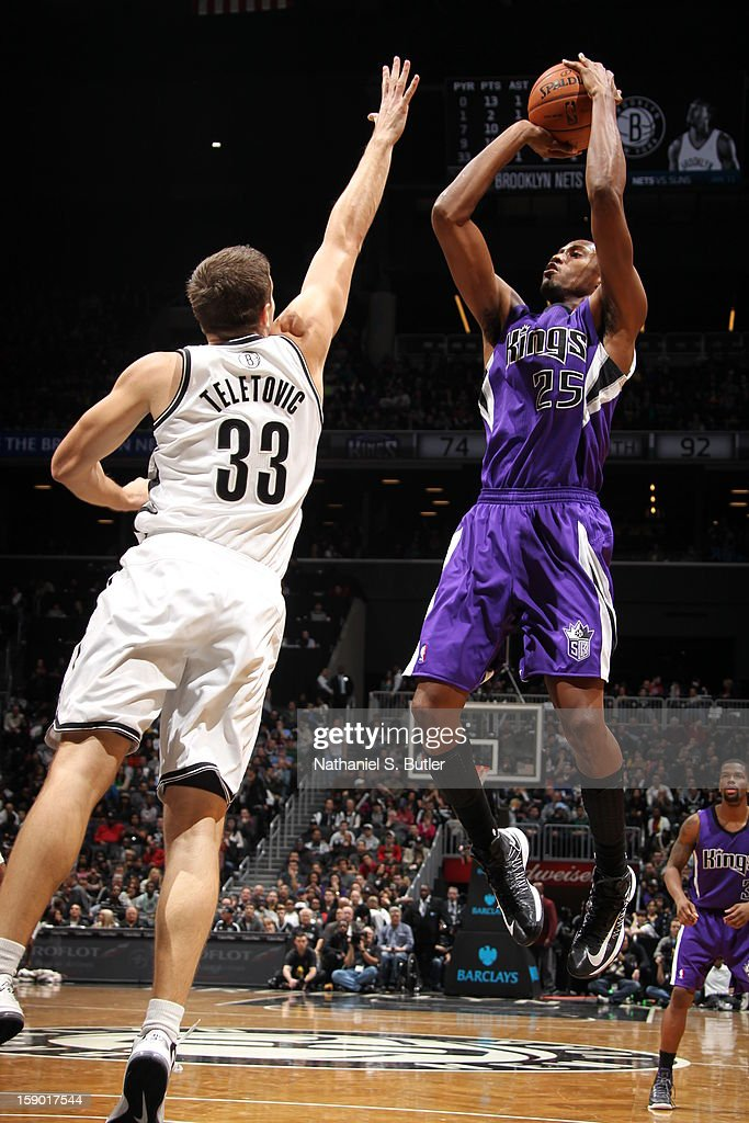 Travis Outlaw #25 of the Sacramento Kings shoots against Mirza Teletovic #33 of the Brooklyn Nets on January 5, 2013 at the Barclays Center in the Brooklyn borough of New York City.