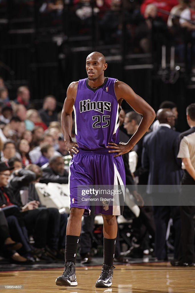 <a gi-track='captionPersonalityLinkClicked' href=/galleries/search?phrase=Travis+Outlaw&family=editorial&specificpeople=203322 ng-click='$event.stopPropagation()'>Travis Outlaw</a> #25 of the Sacramento Kings walks towards the bench against the Portland Trail Blazers on December 26, 2012 at the Rose Garden Arena in Portland, Oregon.
