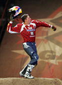 Travis Pastrana celebrates after executing a double backflip winning the Moto X Best Trick final during the ESPN X Games on August 4 2006 at the...