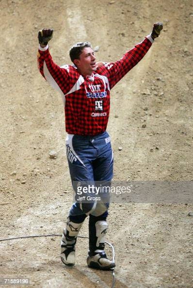Travis Pastrana celebrates after executing a double backflip winning the Moto X Best Trick final during the ESPN X Games August 4 2006 at the Staples...