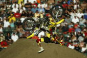 Travis Pastrana competes in the Moto X Freestyle during the X Games on August 8 2004 at the Home Depot Center in Carson California Nate Adams won the...