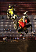 Travis Pastrana does a back flip off of his bike to celebrate his victory in the Moto X Freestyle Final at the Los Angeles Coliseum during X Games 16...