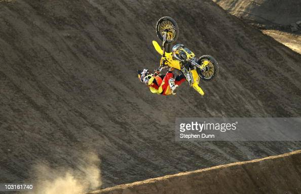 Travis Pastrana does a stunt in the Moto X Freestyle Final at the Los Angeles Coliseum during X Games 16 on July 29 2010 in Los Angeles California