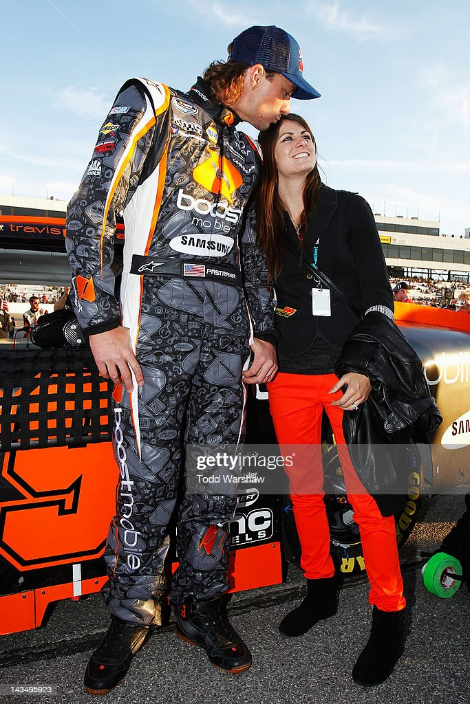 <a gi-track='captionPersonalityLinkClicked' href=/galleries/search?phrase=Travis+Pastrana&family=editorial&specificpeople=710019 ng-click='$event.stopPropagation()'>Travis Pastrana</a> (L), driver of the #99 Boost Mobile Toyota, and his wife Lyn-Z stand on the grid before the NASCAR Nationwide Series Virginia 529 College Savings 250 at Richmond International Raceway on April 27, 2012 in Richmond, Virginia.
