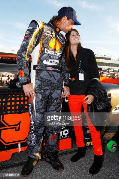 Travis Pastrana driver of the Boost Mobile Toyota and his wife LynZ stand on the grid before the NASCAR Nationwide Series Virginia 529 College...
