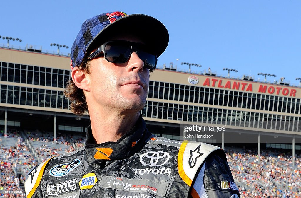 Travis Pastrana, driver of the #99 Boost Mobile Toyota, looks on prior to the start of the NASCAR Nationwide Series NRA American Warrior 300 at Atlanta Motor Speedway on September 1, 2012 in Hampton, Georgia.