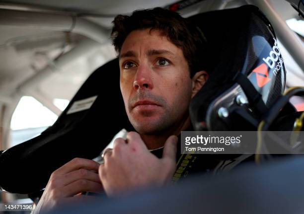 Travis Pastrana driver of the Boost Mobile Toyota sits in his car in the garage during practice for the NASCAR Nationwide Series Virginia 529 College...