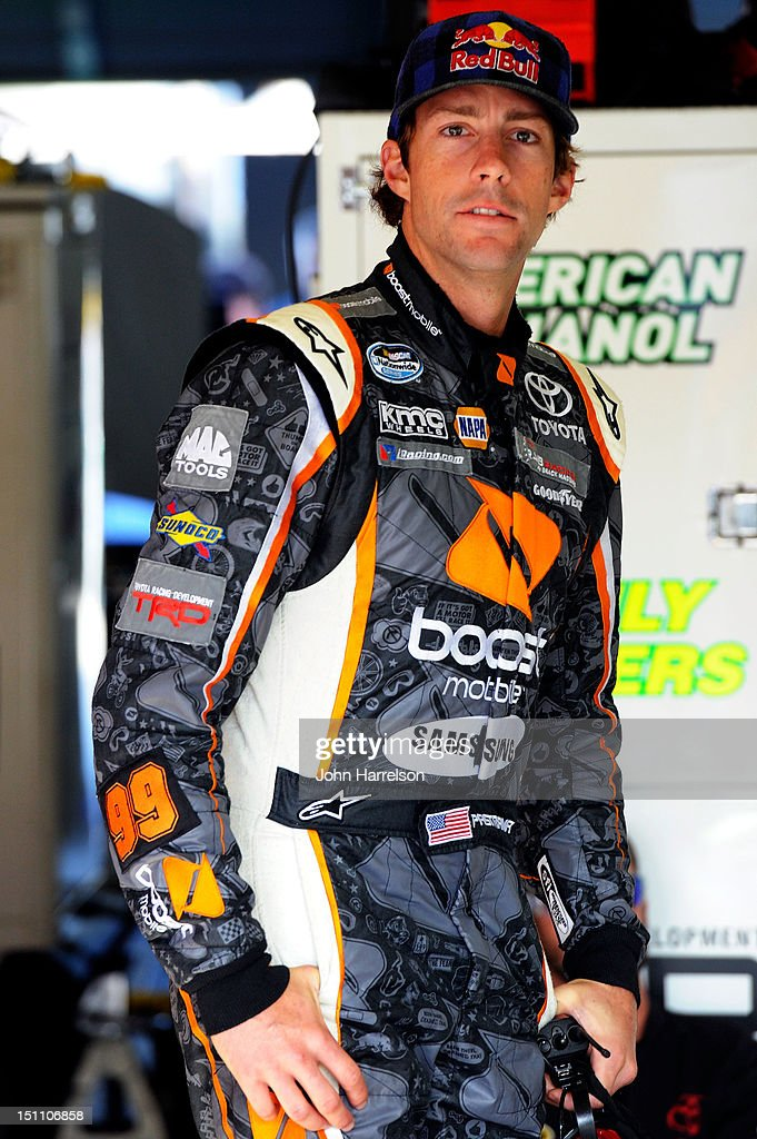 Travis Pastrana, driver of the #99 Boost Mobile Toyota, stands in the garage during practice for the NASCAR Nationwide Series NRA American Warrior 300 at Atlanta Motor Speedway on September 1, 2012 in Hampton, Georgia.