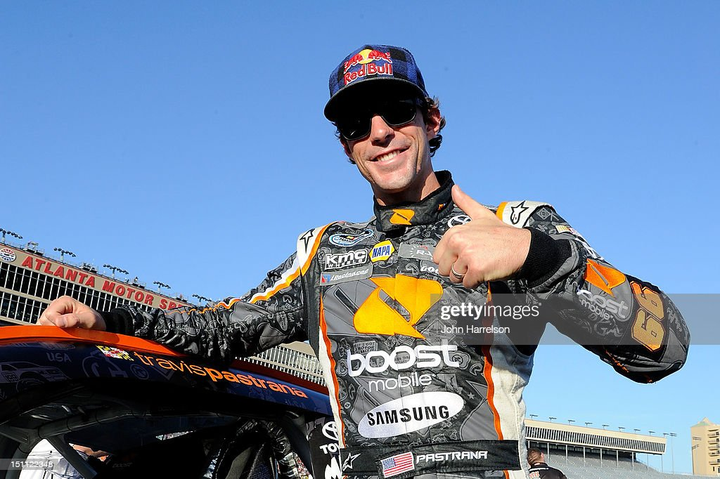 Travis Pastrana, driver of the #99 Boost Mobile Toyota, stands on the grid prior to the start of the NASCAR Nationwide Series NRA American Warrior 300 at Atlanta Motor Speedway on September 1, 2012 in Hampton, Georgia.
