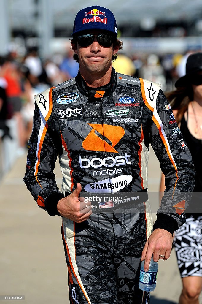 Travis Pastrana, driver of the #60 Ford EcoBoost Ford, gives a thumbs up while walking down pit road during qualifying for the NASCAR Nationwide Series Virginia 529 College Savings 250 at Richmond International Raceway on September 7, 2012 in Richmond, Virginia.