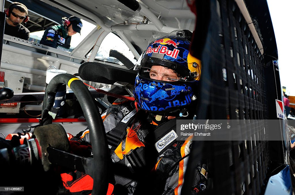 Travis Pastrana, driver of the #60 Ford EcoBoost Ford, sits in his car in the garage during practice for the NASCAR Nationwide Series Virginia 529 College Savings 250 at Richmond International Raceway on September 7, 2012 in Richmond, Virginia.