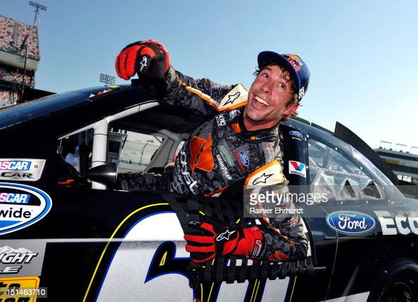 Travis Pastrana driver of the Ford EcoBoost Ford smiles as he gets out of his car during qualifying for the NASCAR Nationwide Series Virginia 529...
