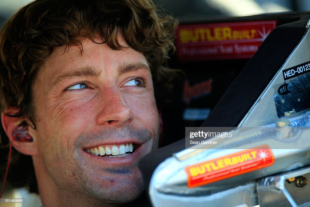 Travis Pastrana, driver of the #60 Ford EcoBoost Ford, smiles in his car during qualifying for the NASCAR Nationwide Series Virginia 529 College Savings 250 at Richmond International Raceway on September 7, 2012 in Richmond, Virginia.