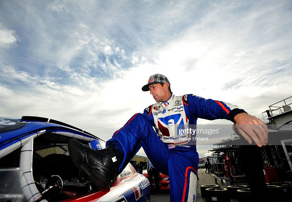 Travis Pastrana, driver of the #99 iRacing.com Toyota, climbs in his car in the garage area during practice for the NASCAR K&N Pro Series East G-Oil 100 at New Hampshire Motor Speedway on September 21, 2012 in Loudon, New Hampshire.