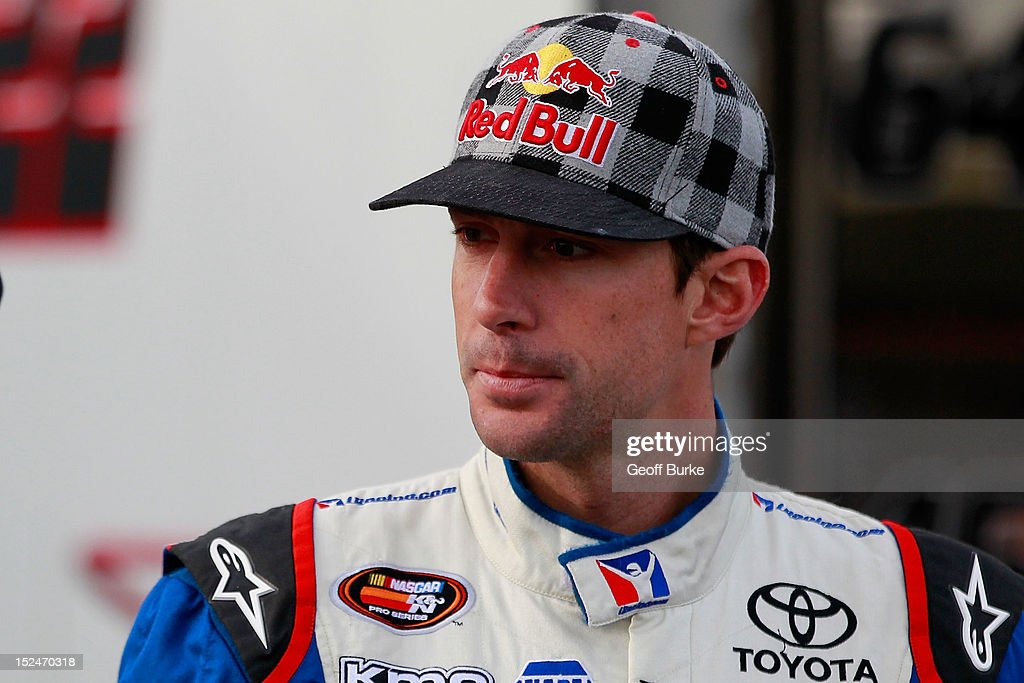 Travis Pastrana, driver of the #99 iRacing.com Toyota, stands in the garage during practice for the NASCAR K&N Pro Series East G-Oil 100 at New Hampshire Motor Speedway on September 21, 2012 in Loudon, New Hampshire.