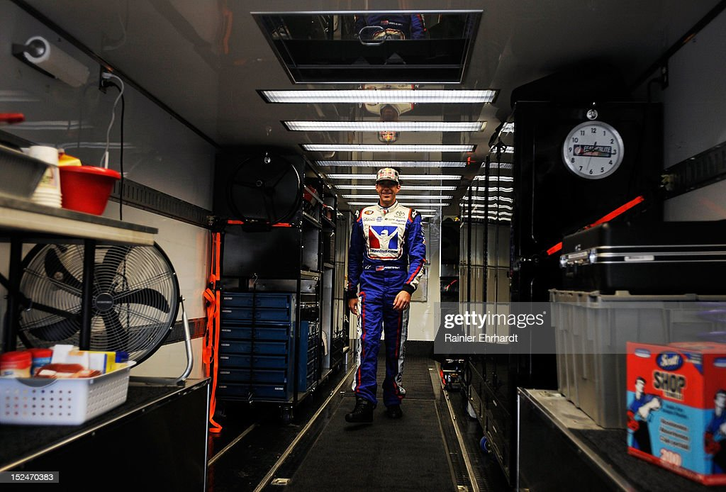 Travis Pastrana, driver of the #99 iRacing.com Toyota, walks in his hauler prior to practice for the NASCAR K&N Pro Series East G-Oil 100 at New Hampshire Motor Speedway on September 21, 2012 in Loudon, New Hampshire.