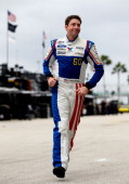 Travis Pastrana driver of the Nitro City Ford walks through the garage area during practice for the NASCAR Nationwide Series Ford EcoBoost 300 at...