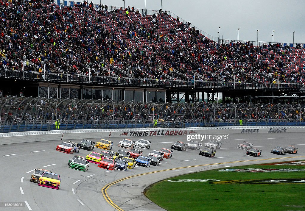 Travis Pastrana driver of the Roush Fenway Racing Ford and Trevor Bayne driver of the Cargill / Blackwell Angus Ford lead the field during the NASCAR...