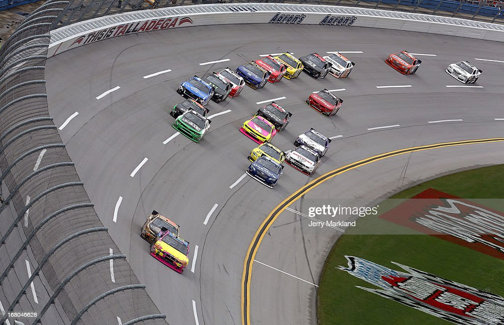 Travis Pastrana driver of the Roush Fenway Racing Ford leads cars through a turn during the NASCAR Nationwide Series Aaron's 312 at Talladega...