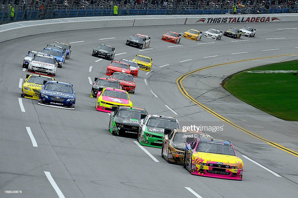 Travis Pastrana driver of the Roush Fenway Racing Ford leads the field during the NASCAR Nationwide Series Aaron's 312 at Talladega Superspeedway on...