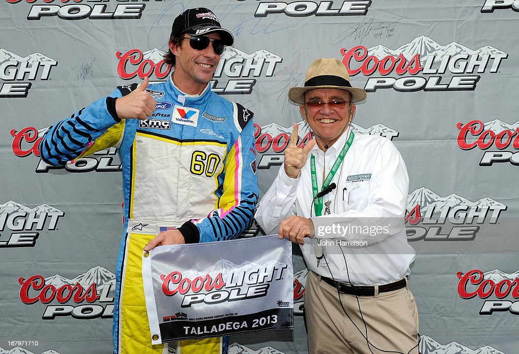 Travis Pastrana, driver of the #60 Roush Fenway Racing Ford, poses with his pole award with team owner Jack Roush after qualifying firist for the NASCAR Nationwide Series Aaron's 312 at Talladega Superspeedway on May 3, 2013 in Talladega, Alabama.