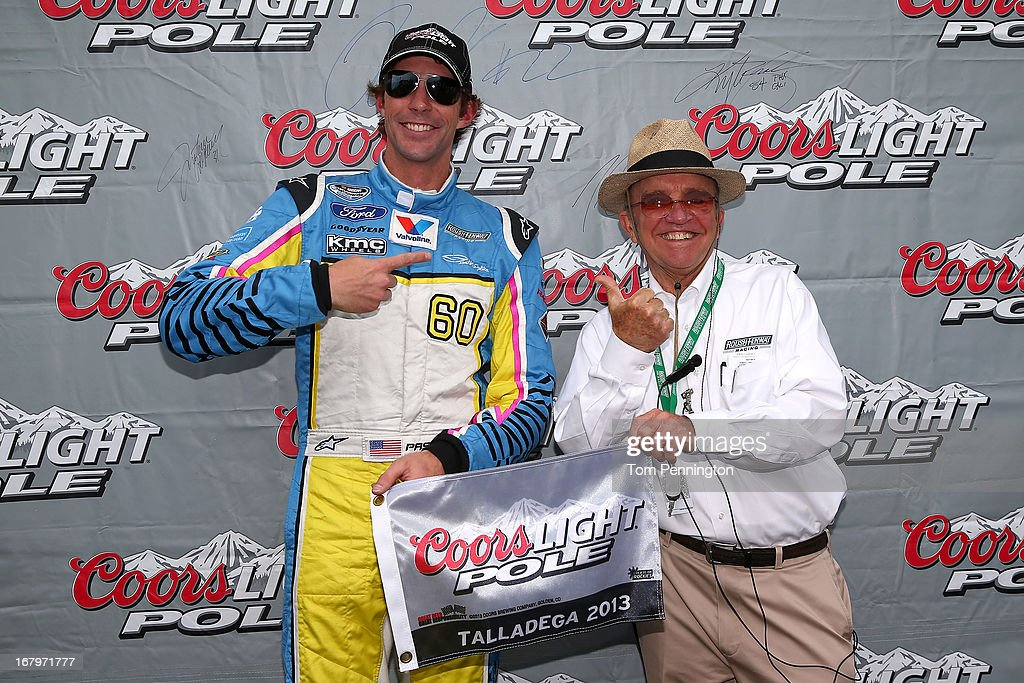 Travis Pastrana, driver of the #60 Roush Fenway Racing Ford, poses with his pole award along with team owner Jack Roush (R) after qualifying firist for the NASCAR Nationwide Series Aaron's 312 at Talladega Superspeedway on May 3, 2013 in Talladega, Alabama.