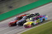 Travis Pastrana driver of the Roush Fenway Racing Ford races Jeremy Clements driver of the Value Lighting/AllSouthElectriccom Chevy and Mike Wallace...