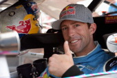 Travis Pastrana driver of the Roush Fenway Racing Ford sits in his car during practice for the NASCAR Nationwide Series Alliance Truck Parts 250 at...