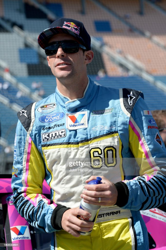 Travis Pastrana, driver of the #60 Roush Fenway Racing Ford, stands on the grid during qualifying for the NASCAR Nationwide Series Dollar General 300 Powered by Coca-Cola at Chicagoland Speedway on September 14, 2013 in Joliet, Illinois.