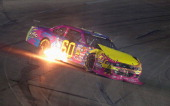 Travis Pastrana driver of the Roush Fenway Racing Ford wrecks during the NASCAR Nationwide Series Kentucky 300 at Kentucky Speedway on September 21...