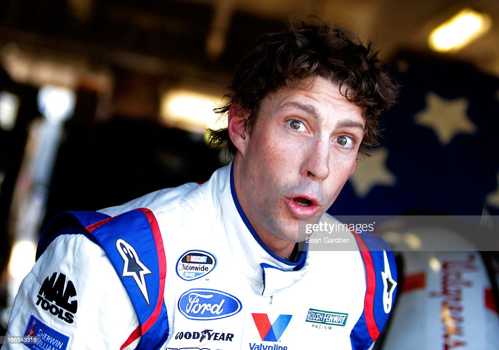 <a gi-track='captionPersonalityLinkClicked' href=/galleries/search?phrase=Travis+Pastrana&family=editorial&specificpeople=710019 ng-click='$event.stopPropagation()'>Travis Pastrana</a>, driver of the #60 Roush Fenway Racing Mustangs Ford, stands in the garage area during practice for the NASCAR Nationwide Series O'Reilly Auto Parts 300 at Texas Motor Speedway on April 11, 2013 in Fort Worth, Texas.