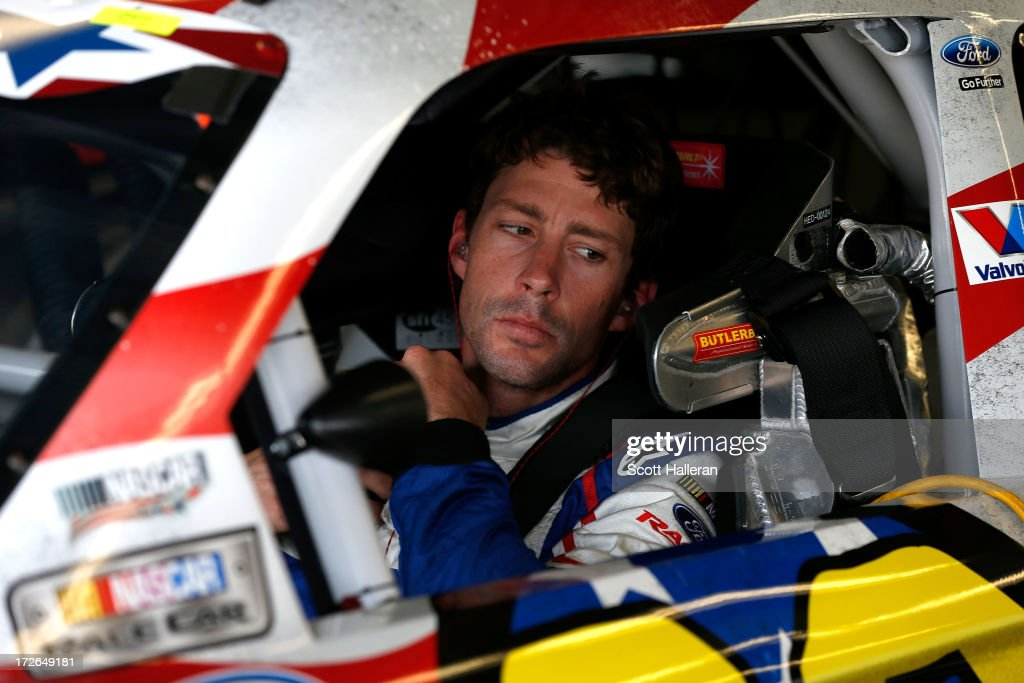 Travis Pastrana, driver of the #60 Roush Fenway Racing / RaceTrac Ford, maes adjustments in his car during practice for the NASCAR Nationwide Series Subway Firecracker 250 at Daytona International Speedway on July 4, 2013 in Daytona Beach, Florida.