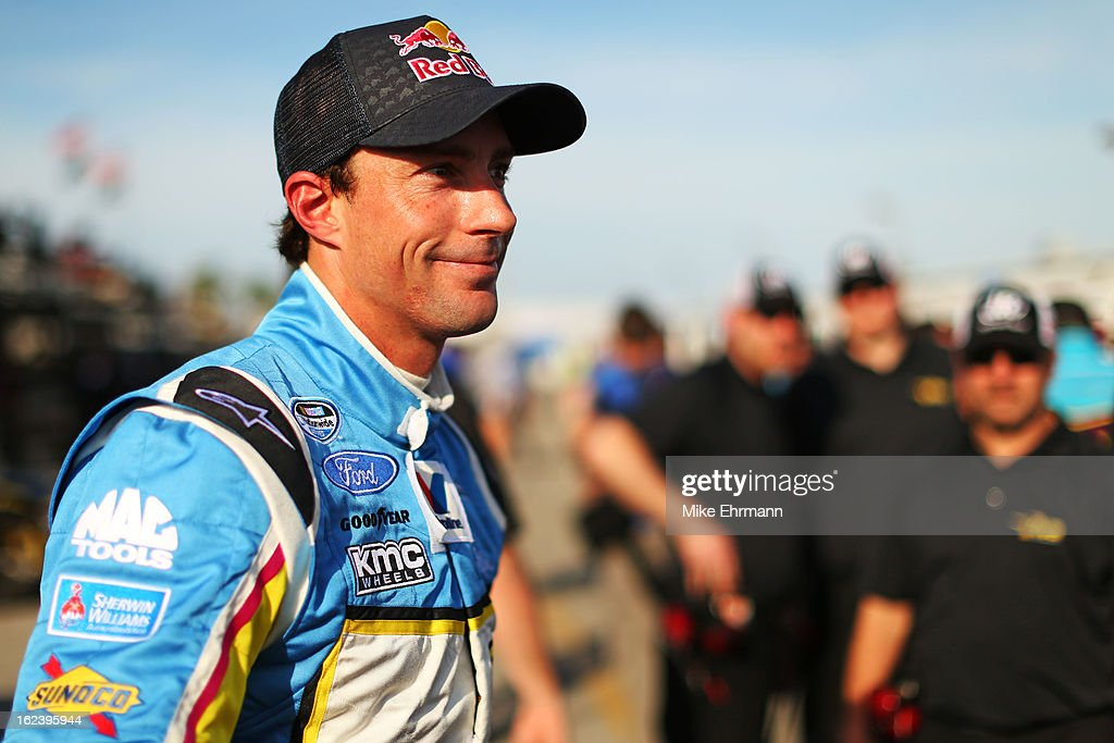 <a gi-track='captionPersonalityLinkClicked' href=/galleries/search?phrase=Travis+Pastrana&family=editorial&specificpeople=710019 ng-click='$event.stopPropagation()'>Travis Pastrana</a>, driver of the #60 Roush-Fenway Racing Ford, stands on the grid during qualifying for the NASCAR Nationwide Series DRIVE4COPD 300 at Daytona International Speedway on February 22, 2013 in Daytona Beach, Florida.