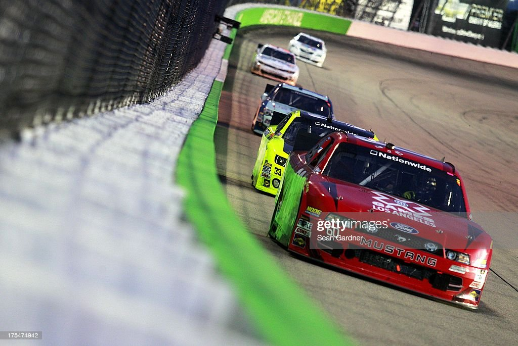 Travis Pastrana, driver of the #60 XGames LA Ford, leads a group of cars during the NASCAR Nationwide Series U.S. Cellular 250 Presented by Enlist Weed Control System at Iowa Speedway on August 3, 2013 in Newton, Iowa.