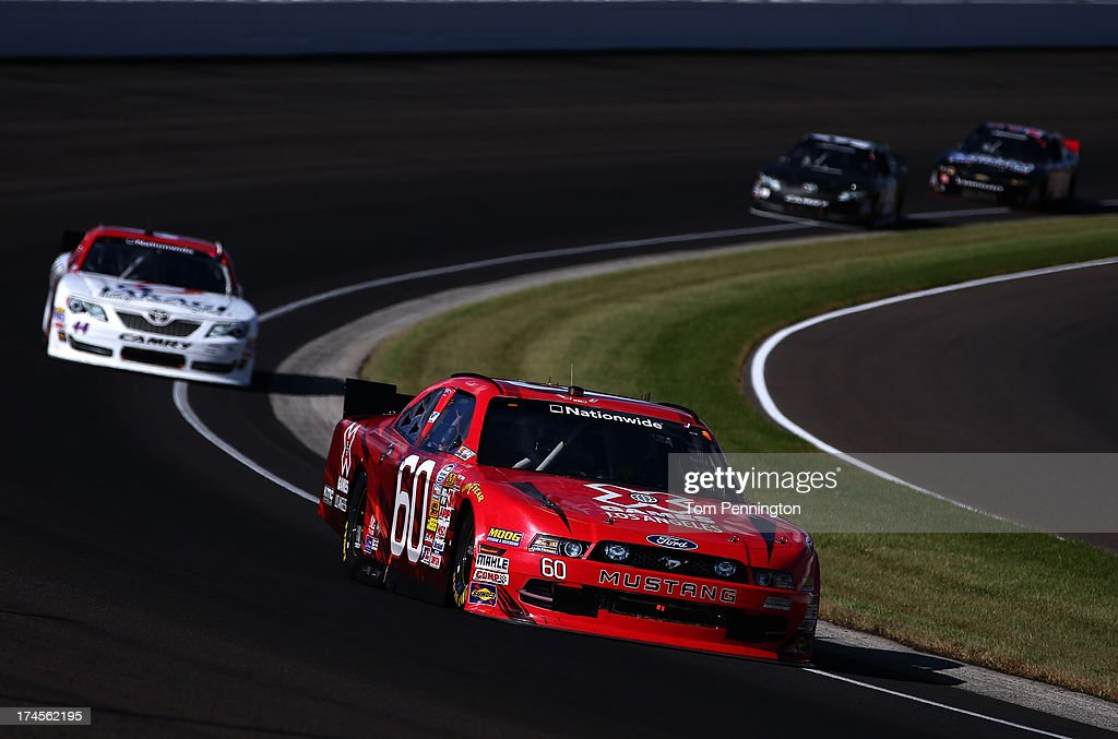 Travis Pastrana, driver of the #60 X-Games LA Ford, leads a pack of cars during the NASCAR Nationwide Series Indiana 250 at Indianapolis Motor Speedway on July 27, 2013 in Indianapolis, Indiana.