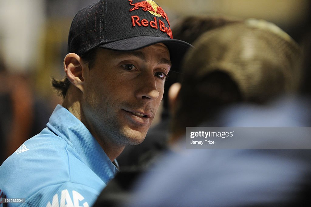 Travis Pastrana signs autographs on Saturday afternoon at the NASCAR Hall of Fame on February 9, 2013 in Charlotte, North Carolina.