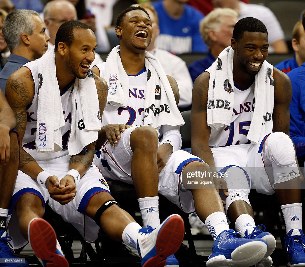 Travis Releford #24, Ben McLemore #23, and Elijah Johnson #15 of the Kansas Jayhawks joke on the bench during the CBE Hall of Fame Classic game against the Washington State Cougars at Sprint Center on November 19, 2012 in Kansas City, Missouri.