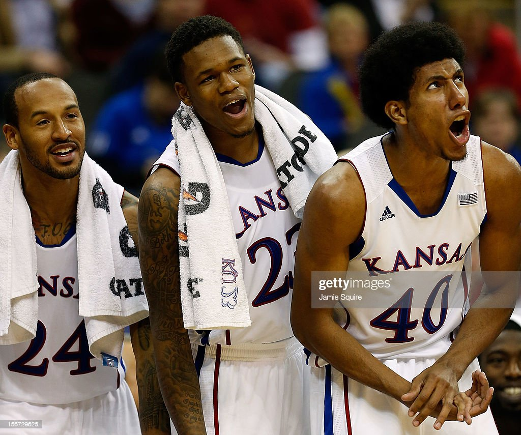 Travis Releford #24, Ben McLemore #23, and Kevin Young #40 of the Kansas Jayhawks react from the bench during the CBE Hall of Fame Classic game against the Washington State Cougars at Sprint Center on November 19, 2012 in Kansas City, Missouri.
