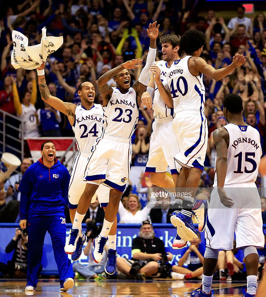 Travis Releford #24, Ben McLemore #23, Jeff Withey #5, and Kevin Young #40 of the Kansas Jayhawks celebrate after Withey hit a three-pointer during the game against the Texas Tech Red Raiders at Allen Fieldhouse on March 4, 2013 in Lawrence, Kansas.