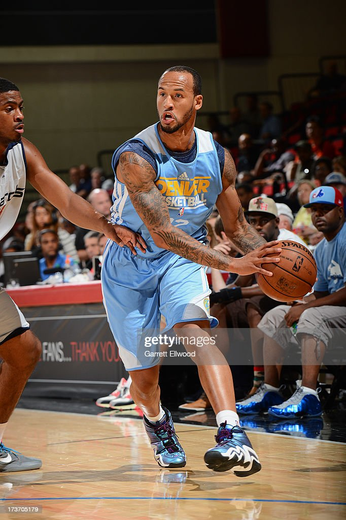 <a gi-track='captionPersonalityLinkClicked' href=/galleries/search?phrase=Travis+Releford&family=editorial&specificpeople=5628041 ng-click='$event.stopPropagation()'>Travis Releford</a> #22 of the Denver Nuggets drives under pressure during NBA Summer League game between the Denver Nuggets and the Washington Wizards on July 16, 2013 at the Cox Pavilion in Las Vegas, Nevada.