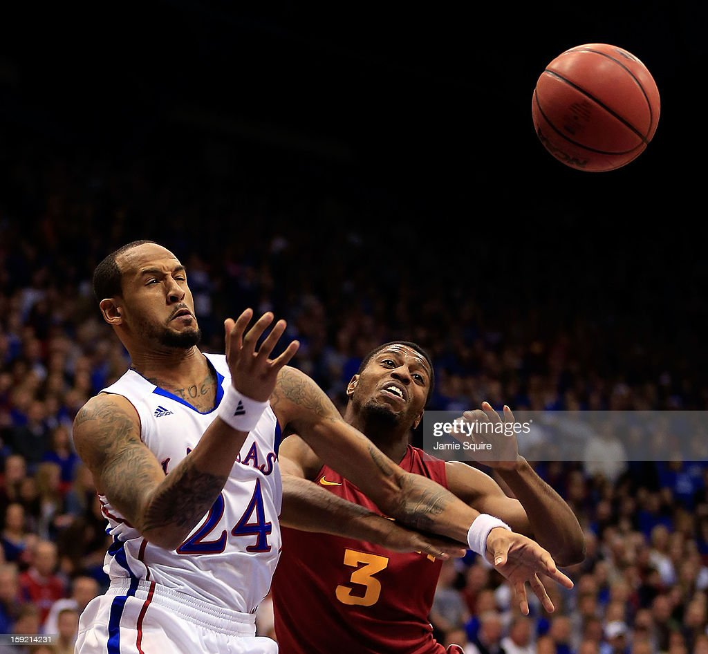 <a gi-track='captionPersonalityLinkClicked' href=/galleries/search?phrase=Travis+Releford&family=editorial&specificpeople=5628041 ng-click='$event.stopPropagation()'>Travis Releford</a> #24 of the Kansas Jayhawks battles Melvin Ejim #3 of the Iowa State Cyclones for a loose ball during the game at Allen Fieldhouse on January 9, 2013 in Lawrence, Kansas.