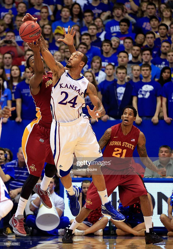 Travis Releford #24 of the Kansas Jayhawks battles Melvin Ejim #3 of the Iowa State Cyclones for a rebound during the game at Allen Fieldhouse on January 9, 2013 in Lawrence, Kansas.
