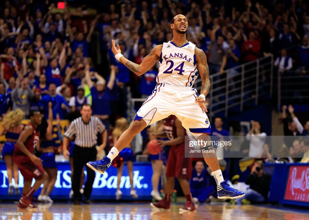 Travis Releford of the Kansas Jayhawks celebrates after sinking a threepointer late in the game against the Temple Owls at Allen Fieldhouse on...