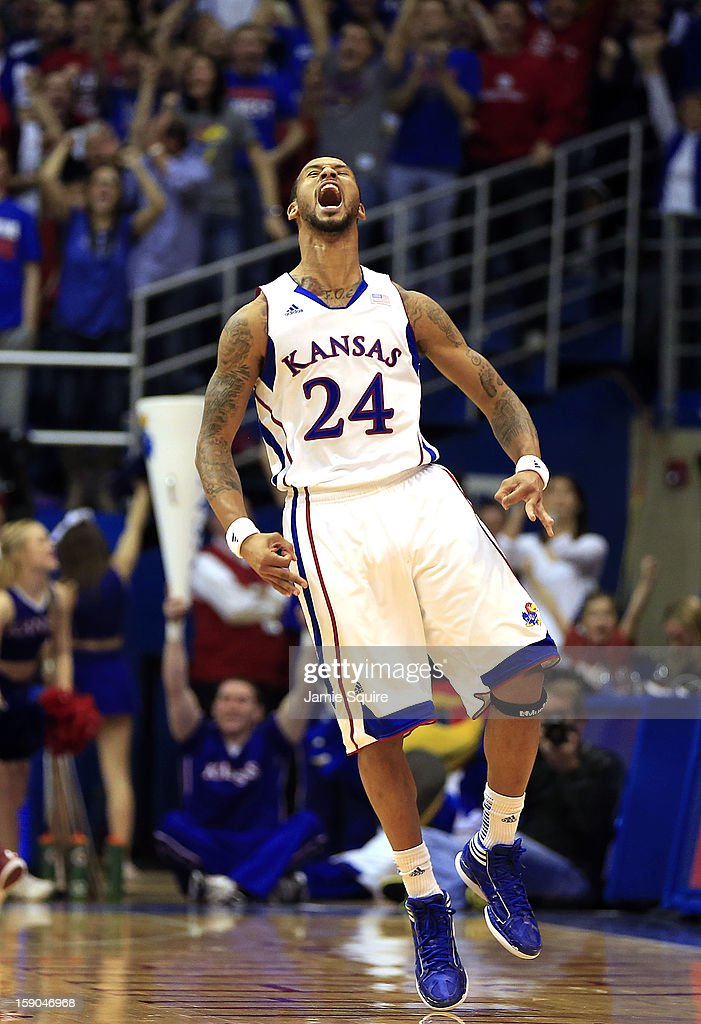 <a gi-track='captionPersonalityLinkClicked' href=/galleries/search?phrase=Travis+Releford&family=editorial&specificpeople=5628041 ng-click='$event.stopPropagation()'>Travis Releford</a> #24 of the Kansas Jayhawks celebrates after sinking a three-pointer late in the game against the Temple Owls at Allen Fieldhouse on January 6, 2013 in Lawrence, Kansas.