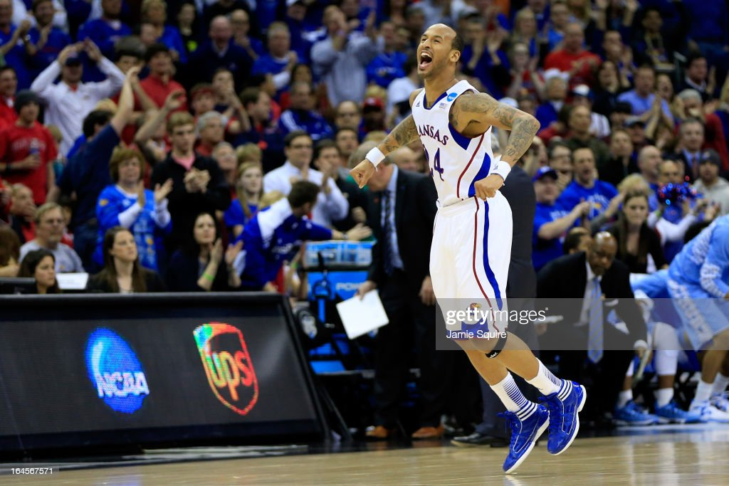 <a gi-track='captionPersonalityLinkClicked' href=/galleries/search?phrase=Travis+Releford&family=editorial&specificpeople=5628041 ng-click='$event.stopPropagation()'>Travis Releford</a> #24 of the Kansas Jayhawks celebrates against the North Carolina Tar Heels during the third round of the 2013 NCAA Men's Basketball Tournament at Sprint Center on March 24, 2013 in Kansas City, Missouri.